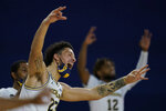 Michigan forward Brandon Johns Jr. (23) and teammates react after a teammate's three-point basket during the second half of an NCAA college basketball game against Central Florida, Sunday, Dec. 6, 2020, in Ann Arbor, Mich. (AP Photo/Carlos Osorio)