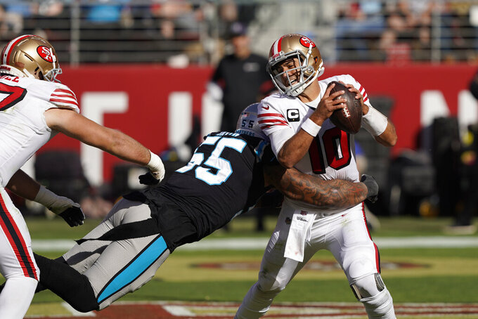 San Francisco 49ers quarterback Jimmy Garoppolo is sacked by Carolina Panthers linebacker Bruce Irvin for a safety during the second half of an NFL football game in Santa Clara, Calif., Sunday, Oct. 27, 2019. (AP Photo/Tony Avelar)
