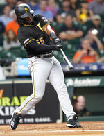 Pittsburgh Pirates' Josh Bell hits a two-run home run against the Houston Astros during the first inning of a baseball game Wednesday, June 26, 2019, in Houston. (AP Photo/David J. Phillip)