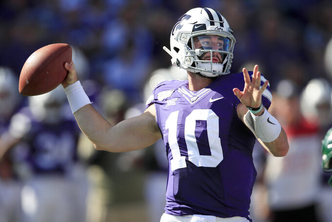 FILE - Kansas State quarterback Skylar Thompson passes to a teammate during the first half of an NCAA college football game against Baylor in Manhattan, Kan., Saturday, Oct. 5, 2019. Arkansas State plays at Kansas State on Saturday, Sept. 12, 2020. (AP Photo/Orlin Wagner, File)