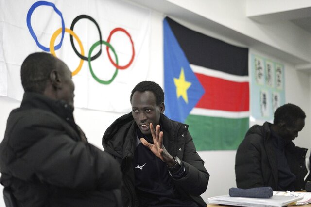 In this Feb. 12, 2020, photo, Abraham Majok, center and other compatriot athletes of the South Sudan team participate in Japanese language lessons as their preparation for the Tokyo 2020 Olympics and Paralympics in Maebashi, Gunma Prefecture, north of Tokyo. (AP Photo/Eugene Hoshiko)