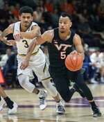 Virginia Tech guard Justin Robinson (5) drives the ball to the basket against Notre Dame guard Prentiss Hubb (3) during the second half of an NCAA college basketball game Tuesday, Jan. 1, 2019, in Blacksburg, Va. Virginia Tech won 81-66. (AP Photo/Don Petersen)