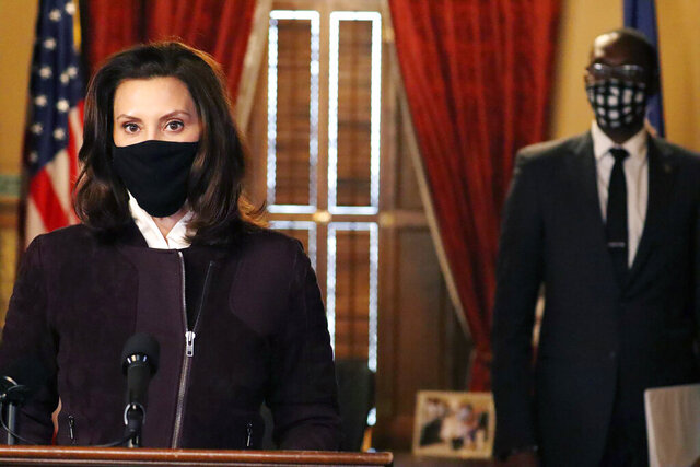 In this photo provided by the Michigan Office of the Governor, Gov. Gretchen Whitmer addresses the state during a speech in Lansing, Mich., Thursday, Dec. 3, 2020. The governor said her administration may extend portions of a three-week partial shutdown of schools and businesses next week because of the