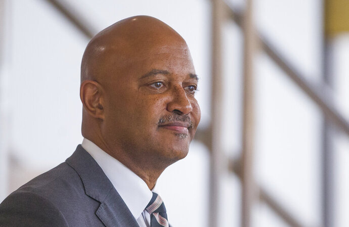 FILE - In this Oct. 3, 2019, file photo, Indiana Attorney General Curtis Hill holds a press conference in South Bend, Ind. Votes are being tallied Friday, July 10, 2020, to decide whether Republicans will nominate Attorney General Hill for a new term despiteallegations of groping four womenthat resulted in amonth-long suspension of his law license. (Robert Franklin/South Bend Tribune via AP, File)