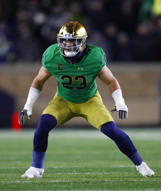 FILE - In this Nov. 10, 2018, file photo, Notre Dame linebacker Drue Tranquill plays against Florida State in the second half of an NCAA college football game in South Bend, Ind. Tranquill, who has suffered a broken left hand and high right ankle sprain during Notre Dame's magical mystery 2018 tour, has remarkably missed just a few plays this season. (AP Photo/Paul Sancya, File)