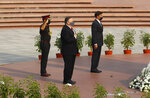 U.S. Secretary of State Mike Pompeo, center, and Secretary of Defence Mark Esper pay their tributes at the National War Memorial in New Delhi, India, Tuesday, Oct. 27, 2020. In talks on Tuesday with their Indian counterparts, Pompeo and Esper are to sign an agreement expanding military satellite information sharing and highlight strategic cooperation between Washington and New Delhi with an eye toward countering China. (Adnan Abidi/Pool via AP)
