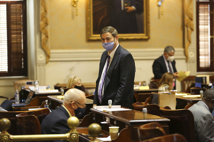 House Ways and Means Chairman Murrell Smith, center, walks through the chamber during the House session on Wednesday, Jan. 27, 2021, in Columbia, S.C. The House gave key approval to a plan to alter how COVID-19 vaccines are distributed in South Carolina. (AP Photo/Jeffrey Collins)