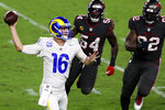 Los Angeles Rams quarterback Jared Goff (16) throws a pass as he is pressured by Tampa Bay Buccaneers inside linebacker Lavonte David (54) and defensive end William Gholston (92) during the first half of an NFL football game Monday, Nov. 23, 2020, in Tampa, Fla. (AP Photo/Mark LoMoglio)