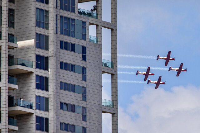 Israeli Air Force aerobatic team flies in formation during celebrations for Israel's 72nd Independence Day, in Tel Aviv, Israel, Wednesday, April 29, 2020. The Israeli government announced a complete lockdown over their Independence Day to control the country's coronavirus outbreak. (AP Photo/Oded Balilty)
