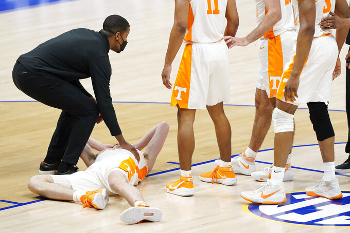 Tennessee's John Fulkerson is attended to after being fouled by Florida's Omar Payne in the second half of an NCAA college basketball game in the Southeastern Conference Tournament Friday, March 12, 2021, in Nashville, Tenn. Payne was ejected from the game. (AP Photo/Mark Humphrey)