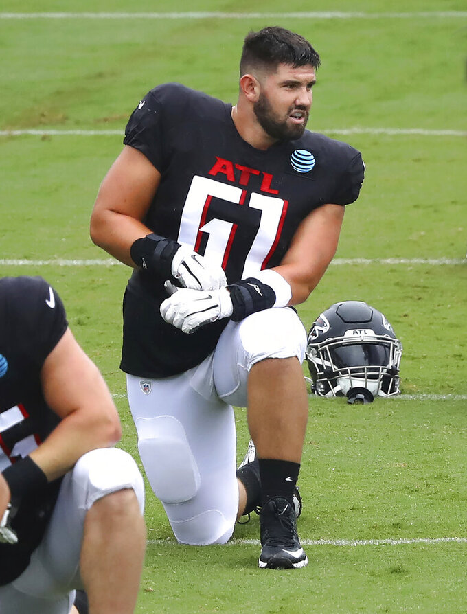 Atlanta Falcons rookie center Matt Hennessy loosens up during an NFL football training camp practice in Flowery Branch, Ga., Monday, Aug. 24, 2020.  (Curtis Compton/Atlanta Journal-Constitution via AP, Pool)