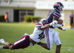 Jackson State Daylen Baldwin is stopped by Alabama A&M's JaBraun McNeal during an NCAA college football game, Saturday, April 10, 2021, at Veterans Memorial Stadium in Jackson, Miss. (Eric Shelton/The Clarion-Ledger via AP)