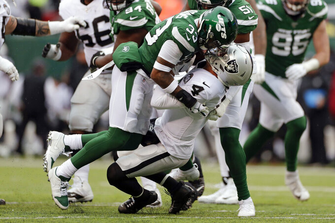 New York Jets strong safety Jamal Adams (33) sacks Oakland Raiders quarterback Derek Carr (4) during the first half of an NFL football game Sunday, Nov. 24, 2019, in East Rutherford, N.J. (AP Photo/Adam Hunger)