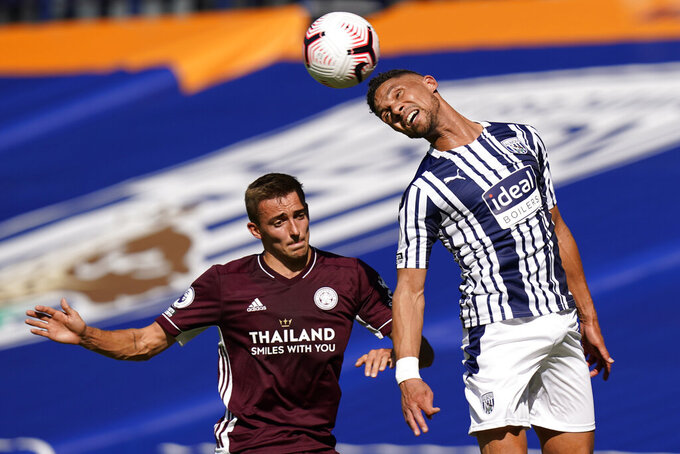 FILE - Leicester's Timothy Castagne, left, and West Bromwich Albion's Kieran Gibbs vie for the ball during the English Premier League soccer match between West Bromwich and Leicester City at the Hawthorns in West Bromwich, England, in this Sunday, Sept. 13, 2020, file photo. The newcomers joining Major League Soccer for the 2021 season lack some of the panache of previous years. In terms of recognizable names, Inter Miami may have landed the biggest by nabbing England left back Kieran Gibbs from West Bromwich Albion. (Tim Keeton/Pool via AP, File)