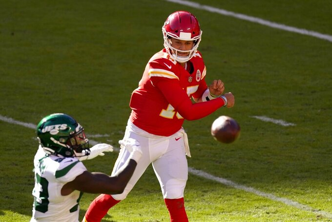 New York Jets cornerback Arthur Maulet, left, pressures as Kansas City Chiefs quarterback Patrick Mahomes (15) throws a pass in the second half of an NFL football game on Sunday, Nov. 1, 2020, in Kansas City, Mo. (AP Photo/Charlie Riedel)