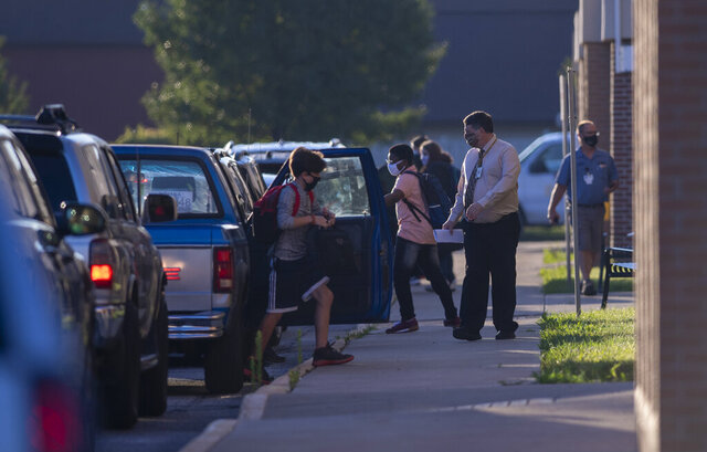 Students of Avon Intermediate School South arrive for their first day back to school in the Avon Community School Corporation, Wednesday, July 29, 2020.  (Doug McSchooler/The Indianapolis Star via AP)