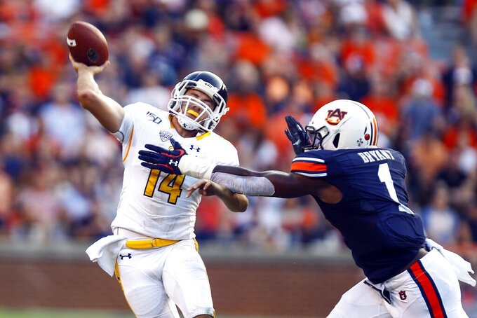 Kent State quarterback Dustin Crum (14) is hit by Auburn defensive end Big Kat Bryant (1) as he throws the ball during the first half of an NCAA college football game Saturday, Sept. 14, 2019, in Auburn, Ala. (AP Photo/Butch Dill)