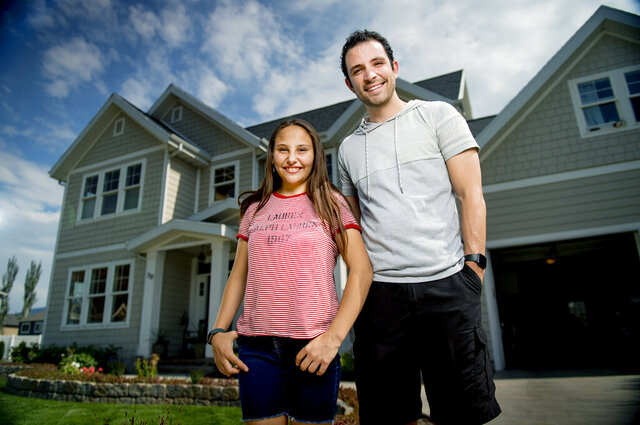 Isabel Rammell, 13, poses for a portrait with her non-biological brother, Skyler Rammell, outside of Isabel's home in Springville, Utah, on Thursday, July 16, 2020. Skyler will be donating his kidney to Isabel, and the hope is to have the procedure take place in August after the procedure was delayed due to COVID-19.  (Isaac Hale/The Daily Herald via AP)
