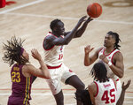 Nebraska forward Lat Mayen (11) passes out to the wing as he's defended by Minnesota's Brandon Johnson (23) during the first half of an NCAA college basketball game Saturday, Feb. 27, 2021, in Lincoln, Neb. (Francis Gardler/Lincoln Journal Star via AP)