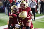 Boston College wide receiver CJ Lewis, left, celebrates his touchdown during the second half of the team's NCAA college football game against Louisville, Saturday, Nov. 28, 2020, in Boston. (AP Photo/Michael Dwyer)