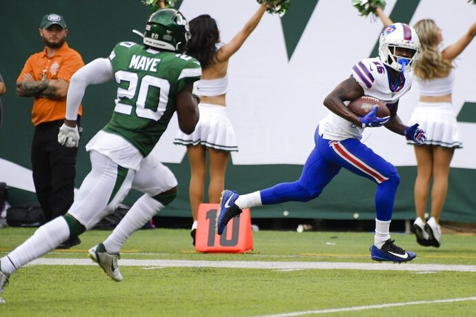 Buffalo Bills' John Brown (15) runs away from New York Jets' Marcus Maye (20) for a touchdown during the second half of an NFL football game Sunday, Sept. 8, 2019, in East Rutherford, N.J. (AP Photo/Bill Kostroun)