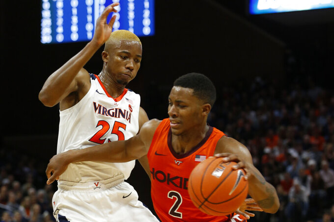 Virginia Tech guard Landers Nolley II (2) runs into Virginia forward Mamadi Diakite (25) during the first half of an NCAA college basketball game in Charlottesville, Va., Saturday, Jan. 4, 2020. (AP Photo/Steve Helber)