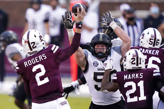 Mississippi State quarterback Will Rogers (2) passes over a rush by Vanderbilt linebacker Ethan Barr (50) during the second half of an NCAA college football game in Starkville, Miss., Saturday, Nov. 7, 2020. (AP Photo/Rogelio V. Solis)
