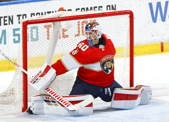 Florida Panthers goaltender Chris Driedger defends the net against the Carolina Hurricanes during the second period of an NHL hockey game Saturday, April 24, 2021, in Sunrise, Fla. (AP Photo/Joel Auerbach)