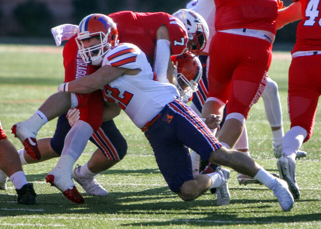 In this image provided by Hobart and William Smith Colleges, Hobart linebacker Emmett Forde tackles Cortland running back Zach Tripodi during the 2019 New York State Bowl on Nov 23, 2019, in Cortland, N.Y. There will be no pregame Victory Walk or singing of the alma mater after wins at Hobart College's 3,000-seat Boswell Field this fall. The coronavirus pandemic has led to the cancellation or postponement of more than 1,800 games across the NCAA, more than 1,000 in Division III.  (Ken Debolt/Hobart and William Smith Colleges via AP)