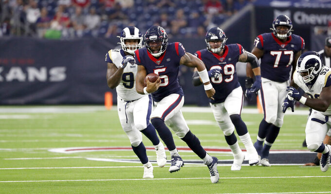 Houston Texans quarterback Joe Webb III (5) runs for gain against the Los Angeles Rams during the first half of a preseason NFL football game Thursday, Aug. 29, 2019, in Houston. (AP Photo/Kevin M. Cox)