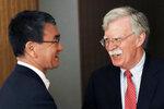 Japanese Foreign Minister Taro Kono, left, and U.S. National Security Advisor John Bolton speak prior to their meeting in Tokyo Monday, July 22, 2019. (AP Photo/Eugene Hoshiko)