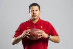 In this undated photo provided by the University of Southern California Athletics,  USC associate coach Donte Williams poses in Los Angeles. Williams, the Trojans' cornerbacks coach and associate head coach, is taking over for the rest of the season alongside offensive coordinator Graham Harrell and defensive coordinator Todd Orlando, after the school fired head coach Clay Helton on Monday, Sept. 13, 2021. (John McGillen/University of Southern California Athletics via AP)
