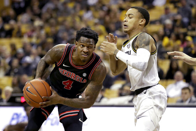 Georgia's Tyree Crump (4) heads to the basket as Missouri's Xavier Pinson defends during the first half of an NCAA college basketball game Tuesday, Jan. 28, 2020, in Columbia, Mo. (AP Photo/Jeff Roberson)