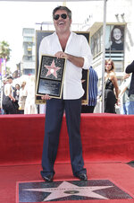 FILE - Simon Cowell attends a ceremony honoring him with a star on the Hollywood Walk of Fame on Aug. 22, 2018, in Los Angeles. Cowell turns 61 on Oct. 7. (Photo by Richard Shotwell/Invision/AP, File)