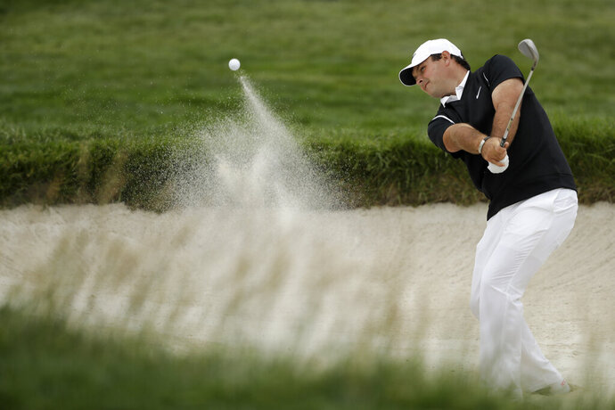 Patrick Reed hits out of the bunker on the sixth hole during the second round of the U.S. Open golf tournament Friday, June 14, 2019, in Pebble Beach, Calif. (AP Photo/Marcio Jose Sanchez)