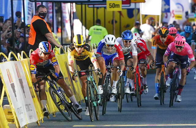 Sprinting for the win Dutch cyclist Fabio Jakobsen, left, hits side barriers at the start of a crash with his countryman Dylan Groenewegen, 2nd left, on the final stretch of the opening stage of the Tour de Pologne race in Katowice, Poland, on Wednesday, Aug. 5, 2020. Injured Jakobsen was taken to hospital in serious condition and put into an induced coma. Jakobsen was declared the winner of the opening stage and Groenewegen was disqualified. (AP Photo/Tomasz Markowski)