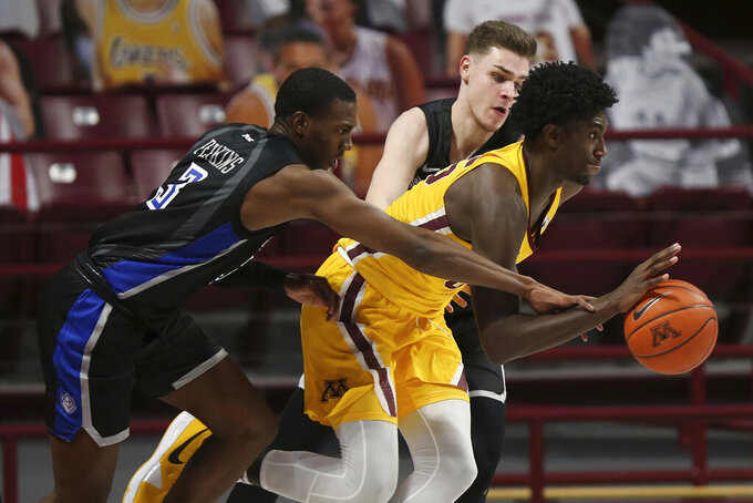 Minnesota's Isaiah Ihnen (35) is fouled by Saint Louis' Javonte Perkins (3) during an NCAA college basketball game, Sunday, Dec. 20, 2020, in Minneapolis. Minnesota won 90-82. (AP Photo/Stacy Bengs)