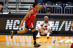 Texas Tech guard Terrence Shannon Jr. (1) celebrates after a three-point basket against Arkansas in the first half of a second-round game in the NCAA men's college basketball tournament at Hinkle Fieldhouse in Indianapolis, Sunday, March 21, 2021. (AP Photo/Michael Conroy)