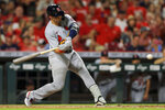 St. Louis Cardinals' Andrew Knizner hits a two-RBI ground rule double during the sixth inning of a baseball game against the Cincinnati Reds in Cincinnati, Friday, July 23, 2021. (AP Photo/Aaron Doster)