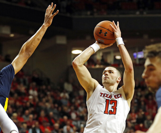 Texas Tech's Matt Mooney (13) shoots the ball during the first half of an NCAA college basketball game against West Virginia, Monday, Feb. 4, 2019, in Lubbock, Texas. (AP Photo/Brad Tollefson)