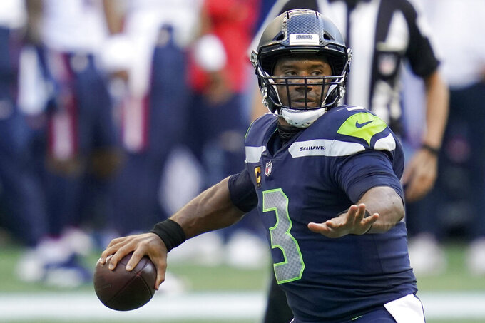 Seattle Seahawks quarterback Russell Wilson passes against the New England Patriots during the first half of an NFL football game, Sunday, Sept. 20, 2020, in Seattle. (AP Photo/Elaine Thompson)