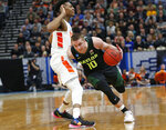 Baylor guard Makai Mason (10) drives around Syracuse guard Tyus Battle, left, during the second half of a first-round game in the NCAA men's college basketball tournament Thursday, March 21, 2019, in Salt Lake City. (AP Photo/Rick Bowmer)
