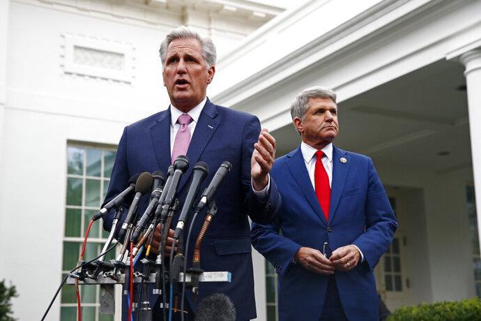 House Minority Leader Kevin McCarthy of Calif., left, speaks with members of the media alongside Rep. Mike McCaul, R-Texas, outside of the West Wing of the White House, Wednesday, Oct. 16, 2019, in Washington, after meeting with President Donald Trump. (AP Photo/Patrick Semansky)
