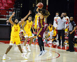 Minnesota forward Brandon Johnson, right, shoots against Maryland forward Donta Scott during the first half of an NCAA college basketball game, Sunday, Feb. 14, 2021, in College Park, Md. (Kevin Richardson/The Baltimore Sun via AP)