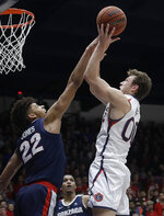 Saint Mary's guard Tanner Krebs, right, shoots against Gonzaga forward Jeremy Jones (22) during the first half of an NCAA college basketball game in Moraga, Calif., Saturday, March 2, 2019. (AP Photo/Jeff Chiu)