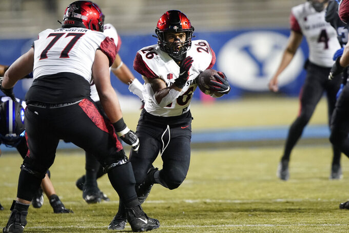 San Diego State running back Kaegun Williams (26) runs for a touchdown during the first half of the team's NCAA college football game against BYU on Saturday, Dec. 12, 2020, in Provo, Utah. (AP Photo/George Frey, Pool)