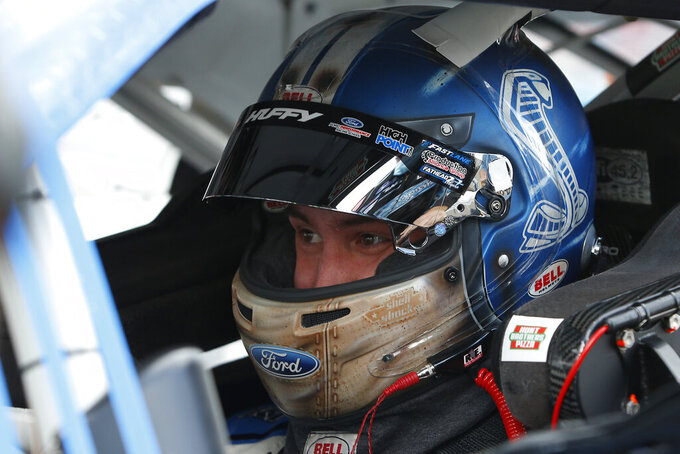 Chase Briscoe sits in his race car prior to a NASCAR Xfinity Series auto race at Phoenix Raceway, Saturday, Nov. 7, 2020, in Avondale, Ariz. (AP Photo/Ralph Freso)