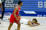 Michigan forward Terrance Williams II (5) lays on the court after a 68-67 loss to Ohio State in an NCAA college basketball game at the Big Ten Conference tournament in Indianapolis, Saturday, March 13, 2021. (AP Photo/Michael Conroy)