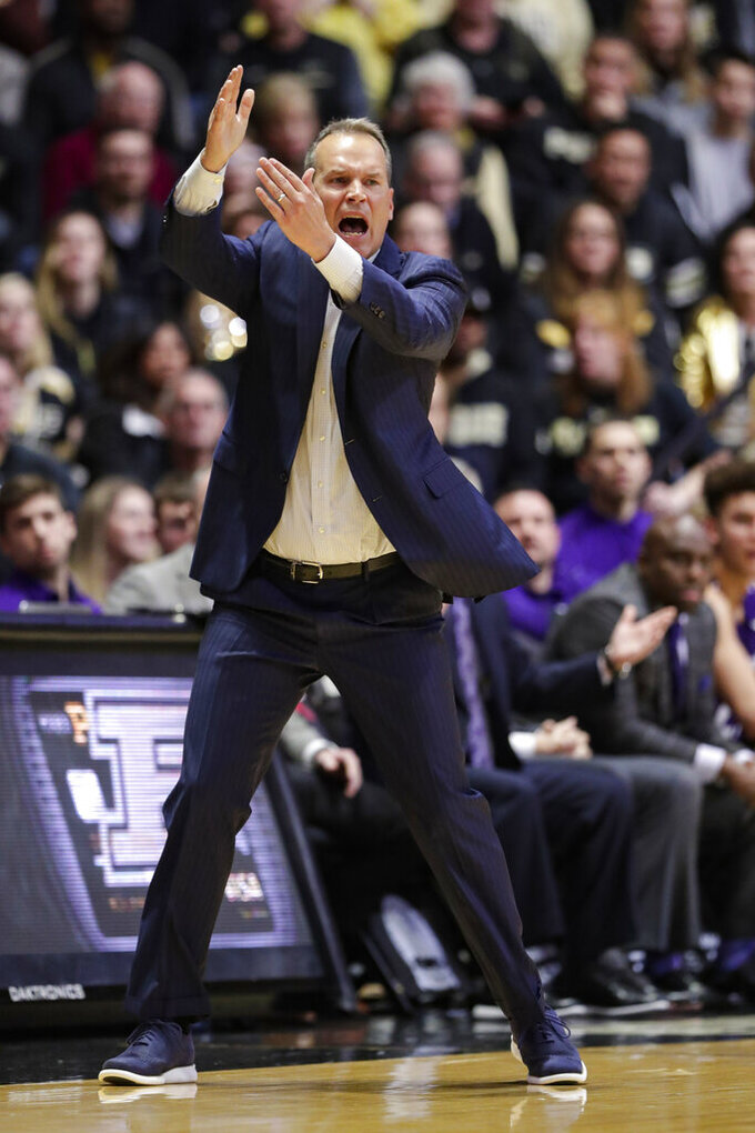 Northwestern head coach Chris Collings calls for a time out as his team played against Purdue during the first half of an NCAA college basketball game in West Lafayette, Ind., Sunday, Dec. 8, 2019. (AP Photo/Michael Conroy)
