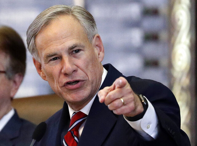 FILE - In this Feb. 5, 2019, file photo, Texas Gov. Greg Abbott gives his State of the State Address in the House Chamber in Austin, Texas. Two former members of the State Commission on Judicial Conduct said they believe Texas Gov. Greg Abbott removed them from the panel because he disagreed with them over a same-sex marriage case. (AP Photo/Eric Gay, File)